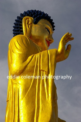 close-up of the golden buddha statue - MUB 8